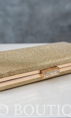 малка златна чанта с метален обков и камъни