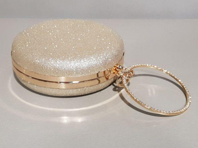 кръгла брокатена бална чанта с метална дръжка
